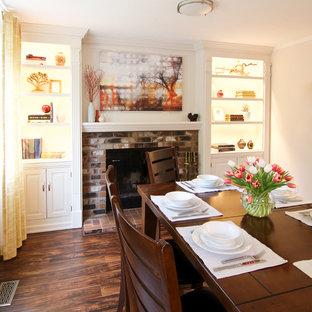 Ispirazione per una sala da pranzo chic di medie dimensioni con pareti bianche, pavimento in laminato, camino classico, cornice del camino in mattoni e pavimento marrone