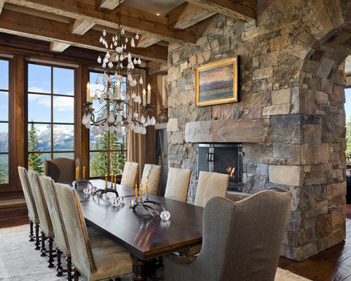 Inspiration For A Rustic Dark Wood Floor Dining Room Remodel In Other With Standard Fireplace
