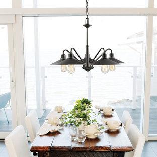 Foto di una sala da pranzo stile marinaro di medie dimensioni con pavimento con piastrelle in ceramica