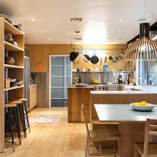 Example Of A Trendy Light Wood Floor And Brown Floor Kitchen/dining Room  Combo Design
