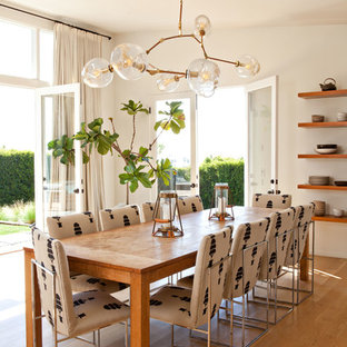 Dining room - contemporary medium tone wood floor and brown floor dining room idea in Los Angeles with white walls