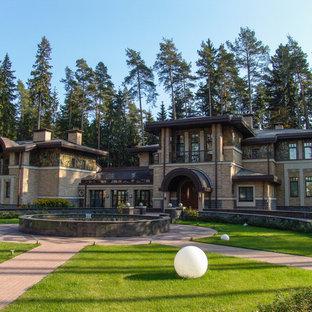 Удачное сочетание для дизайна помещения: двухэтажный фасад дома коричневого цвета в классическом стиле - самое интересное для вас