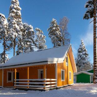 Farmhouse orange two-story wood exterior home photo in Saint Petersburg