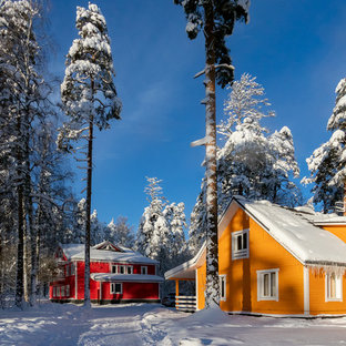 Example of a small cottage orange two-story wood exterior home design in Saint Petersburg
