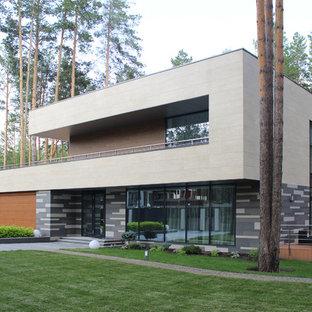 На фото: двухэтажный частный загородный дом среднего размера в современном стиле с плоской крышей с