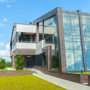 Новые идеи обустройства дома: двухэтажный фасад дома коричневого цвета в современном стиле