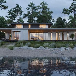 Свежая идея для дизайна: двухэтажный, разноцветный фасад частного дома в современном стиле с комбинированной облицовкой и плоской крышей - отличное фото интерьера