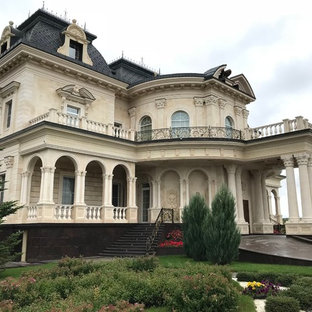 Victorian beige three-story house exterior idea in Moscow