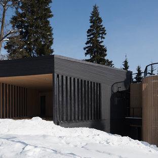 Неиссякаемый источник вдохновения для домашнего уюта: двухэтажный, черный частный загородный дом в современном стиле с односкатной крышей