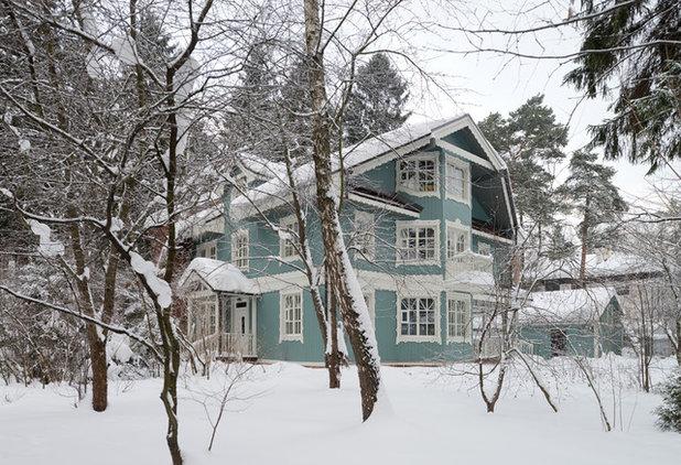 Кантри Фасад дома by Архитектурная мастерская Petr & Pavel