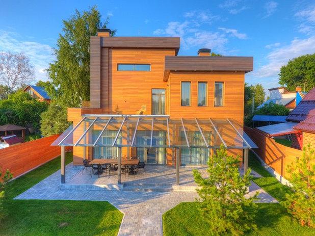 Современный Фасад дома by Vesco Construction
