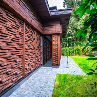 Danish brown wood exterior home photo in Moscow