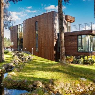 Новый формат декора квартиры: фасад дома в современном стиле с облицовкой из дерева