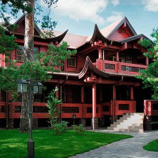 Пример оригинального дизайна: двухэтажный, деревянный, красный частный загородный дом в восточном стиле