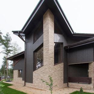 Свежая идея для дизайна: фасад дома среднего размера в современном стиле - отличное фото интерьера