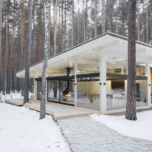 Источник вдохновения для домашнего уюта: большой, одноэтажный, стеклянный, белый частный загородный дом в современном стиле с односкатной крышей