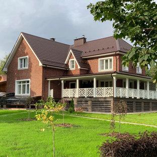 Idéer för ett stort modernt oranget hus, med två våningar, tegel, mansardtak och tak med takplattor