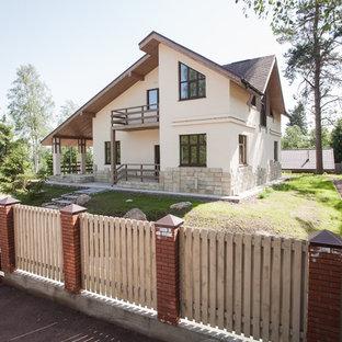 Новые идеи обустройства дома: двухэтажный фасад частного дома в стиле современная классика с крышей из гибкой черепицы