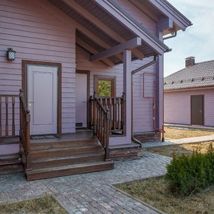Large purple two-story wood exterior home photo in Moscow with a metal roof