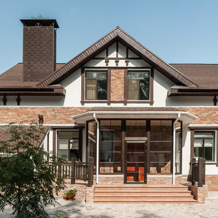 На фото: двухэтажные фасады частных домов в современном стиле с двускатной крышей