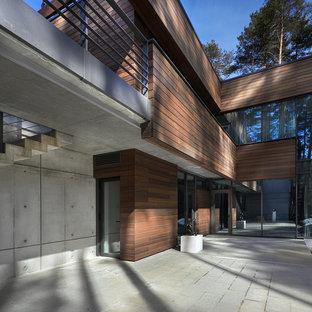 Пример оригинального дизайна интерьера: двухэтажный фасад дома в современном стиле