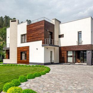 Свежая идея для дизайна: разноцветный, двухэтажный частный загородный дом в современном стиле с комбинированной облицовкой и плоской крышей - отличное фото интерьера