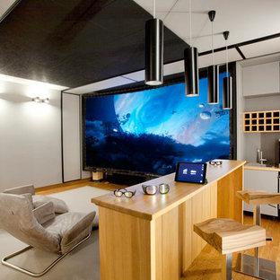 Свежая идея для дизайна: линейный мини-бар с мойкой в современном стиле с накладной раковиной, плоскими фасадами, серыми фасадами, паркетным полом среднего тона, коричневым полом и коричневой столешницей - отличное фото интерьера