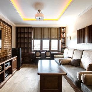 Пример оригинального дизайна: изолированный домашний кинотеатр среднего размера в стиле современная классика с бежевыми стенами, паркетным полом среднего тона, коричневым полом и телевизором на стене