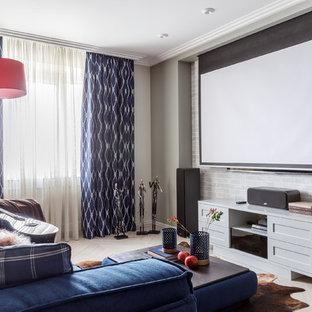 Стильный дизайн: домашний кинотеатр в современном стиле с серыми стенами и экраном для проектора - последний тренд