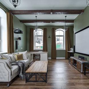 Неиссякаемый источник вдохновения для домашнего уюта: домашний кинотеатр среднего размера в классическом стиле с зелеными стенами, полом из керамогранита, коричневым полом и экраном для проектора