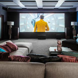 Пример оригинального дизайна: изолированный домашний кинотеатр в современном стиле с черными стенами, ковровым покрытием и серым полом