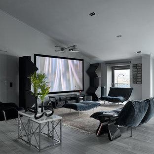 Стильный дизайн: домашний кинотеатр в современном стиле с белыми стенами, светлым паркетным полом, проектором и серым полом - последний тренд