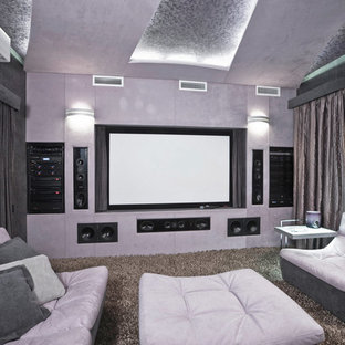 Large contemporary enclosed home cinema in Moscow with purple walls, carpet, a projector screen and brown floors.