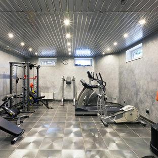 Создайте стильный интерьер: тренажерный зал среднего размера в современном стиле с серыми стенами - последний тренд
