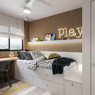 На фото: маленькая детская в стиле модернизм с спальным местом, белыми стенами, полом из керамогранита, серым полом и деревянными стенами для ребенка от 1 до 3 лет, мальчика с