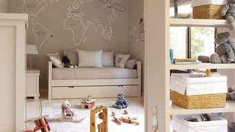 Habitacion infantil con mural mapamundi