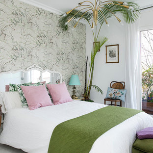 Inspiration for a mid-sized tropical master bedroom remodel in Barcelona with multicolored walls and no fireplace