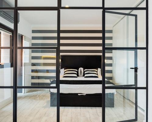 foto de dormitorio principal minimalista de tamao medio sin chimenea con paredes