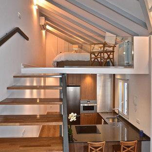 Ejemplo de dormitorio tipo loft, industrial, de tamaño medio, con paredes blancas y suelo de madera pintada