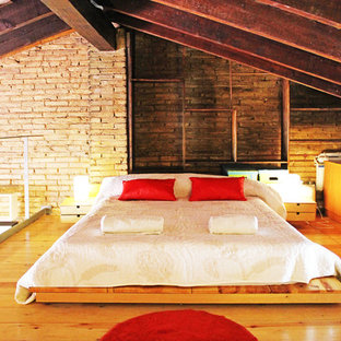 This is an example of a mid-sized industrial loft-style bedroom in Valencia.