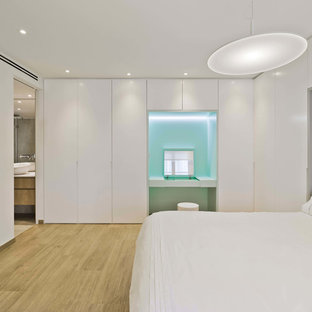 Mid-sized contemporary master bedroom in Alicante-Costa Blanca with white walls, ceramic floors, no fireplace and brown floor.
