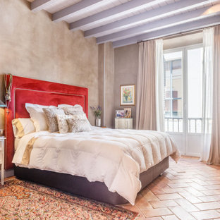 Mediterranean bedroom in Other with grey walls, terra-cotta floors, red floor, exposed beam and timber.