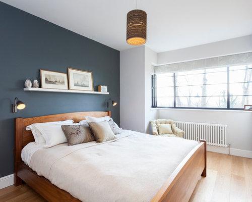 foto de dormitorio principal escandinavo de tamao medio sin chimenea con paredes