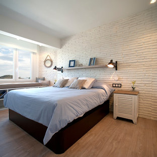 Small coastal guest laminate floor bedroom photo in Bilbao with white walls