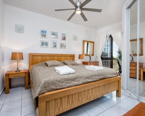 imagen de dormitorio principal de estilo de casa de campo de tamao medio