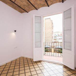 Example of an eclectic yellow floor bedroom design in Barcelona