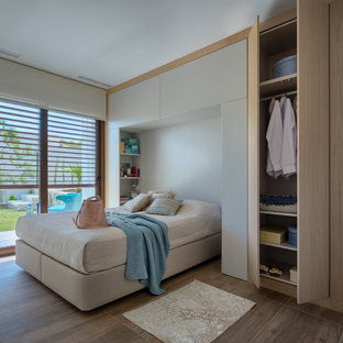 Example Of A Mid Sized Minimalist Master Brown Floor Bedroom Design In  Alicante Costa