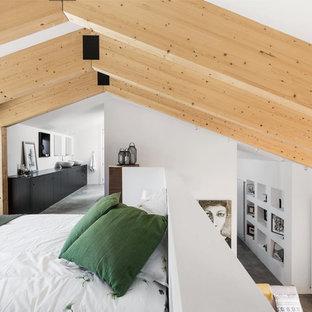 Diseño de dormitorio tipo loft, contemporáneo, de tamaño medio, sin chimenea, con paredes blancas, suelo de cemento y suelo gris