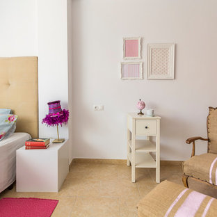 Design ideas for a mid-sized scandinavian guest bedroom in Other with white walls, terra-cotta floors and beige floor.