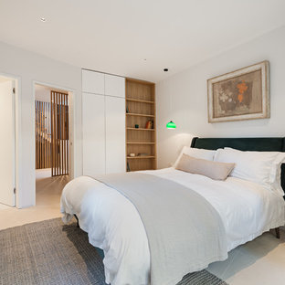 Inspiration for a contemporary master bedroom in Hampshire with white walls, no fireplace and beige floors.